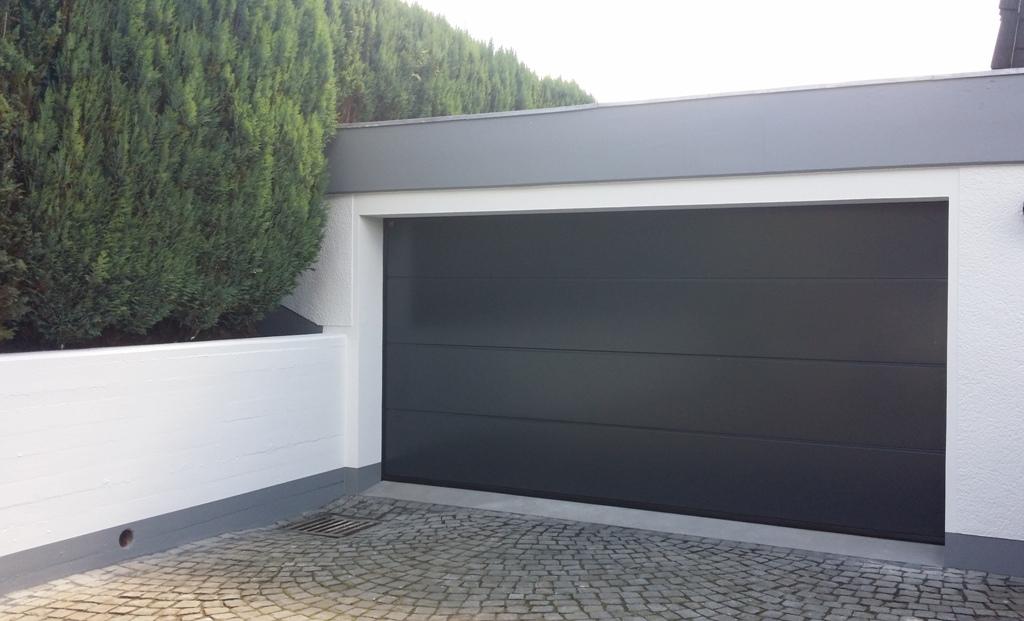 Garagentor hörmann oberfläche  Referenzen von TAROTORE | Garagentore | Industrietore | Haustüren ...